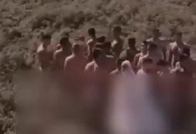 URNEBESNO Evo šta je 20 GOLIH MUŠKARACA sa jednom mladom snimalo u žitu (VIDEO)