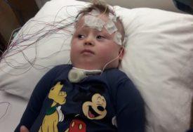 NIKOLA (4) SE VRAĆA IZ TURSKE JER NEMA NOVCA ZA LIJEČENJE Pored Daunovog sindroma ovaj hrabri dječak je i nepokretan