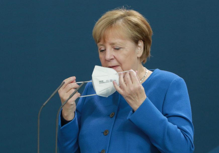 MASKE I NA OTVORENOM Merkel najavila produženje restriktivnih mjera najmanje do 20. DECEMBRA