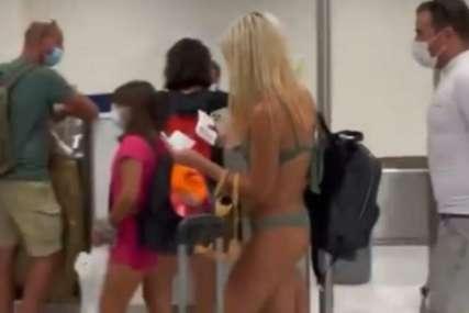 Pobrkala modnu i avionsku pistu: Golišava djevojka prošetala aerodromom i ŠOKIRALA SVE PRISUTNE (VIDEO)